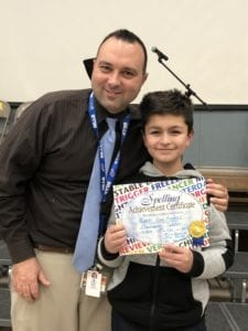 photo of student with principal